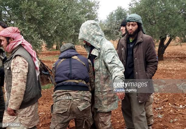 Members of Syrian opponents body search Daesh militants who tried to infiltrate Idlib deescalation zone via Assad Regime's corridor after they were...
