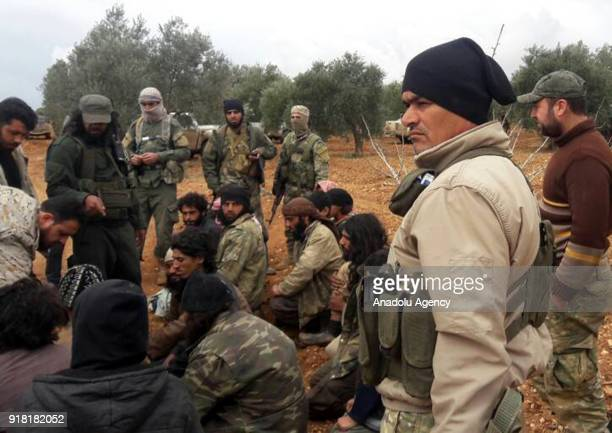 Members of Syrian opponents interrogate Daesh militants who tried to infiltrate Idlib deescalation zone via Assad Regime's corridor after they were...