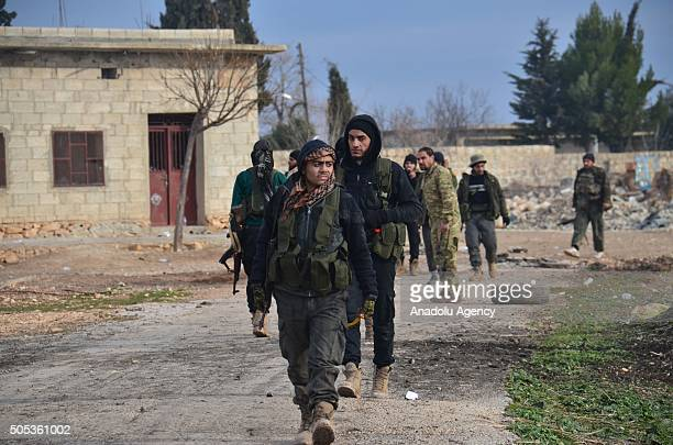 Members of Syrian opposition AlSultan Murad Brigade and AlMutasim Battalion patrol at the Yanyaban village in Aleppo Syria on January 17 2016 after...