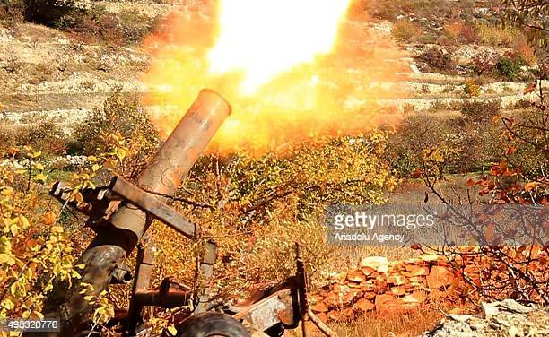 Members of Syrian opposition Fatah forces attack regime controlled Cub el Ahmar region with grad missiles in Latakia Syria on November 22 2015