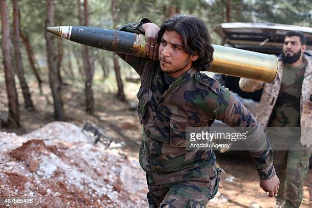 Members of Syrian opposition group called 'Ceys'ul Fatih' carry armories during an offensive to seize control over the northwestern city of Idlib...