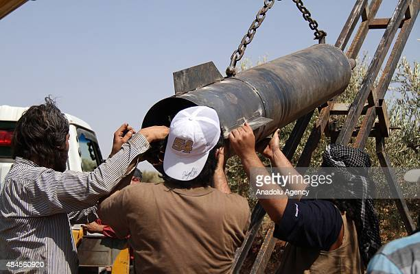 Members of Syrian opposition group linked to Damascus Front place a 200 kg and 150 m range of missile called 'Pigeon' made by themselves to fight...