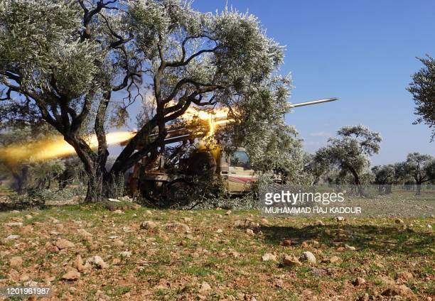 Members of Syria's opposition National Liberation Front remotely-fire a rocket at a position near the village of al-Nayrab, about 14 kilometres...