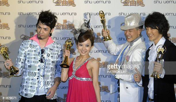 Members of Taiwan hip hop band Da Mouth pose after collecting the Best Group award at the 19th Golden Melody Awards Mandarin's equivalent to the...