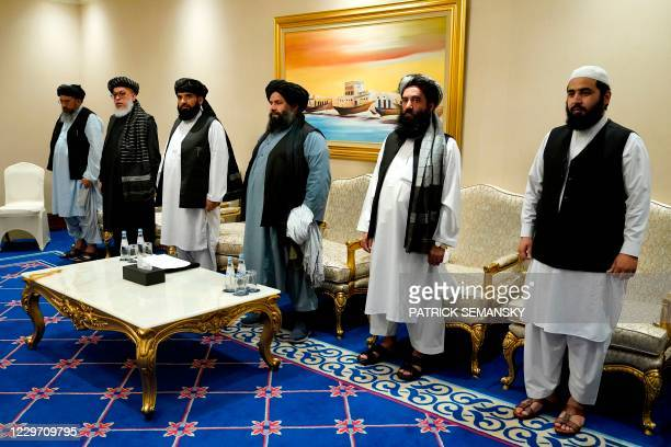 Members of Talibans peace negotiation team attend a meeting with US Secretary of State Mike Pompeo in the Qatari capital Doha, on November 21, 2020....