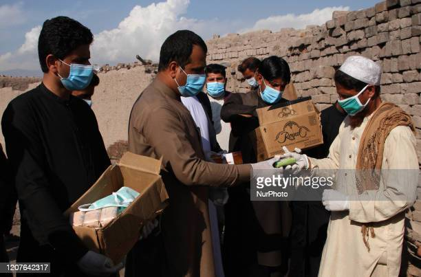 Members of Tawaan Foundation, distribute face mask, gloves and disinfectants to the villagers during a campaign spreading the awareness of the...
