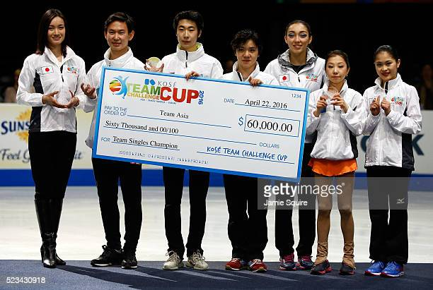 Members of Team Asia display a check after winning the Team Singles Competition on day 1 of the KOSE Team Challenge at Spokane Arena on April 22 2016...