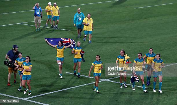 Members of team Australia celebrate winning the Gold medal after the Women's Gold Medal Rugby Sevens match between Australia and New Zealand on Day 3...