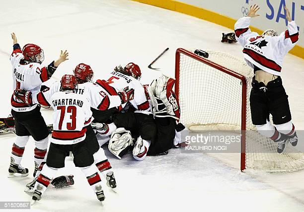 Members of team Canada celebrate after their Women's Gold Medal Ice Hockey Final against the USA at the XIX Winter Olympics 21 February 2002 at the E...