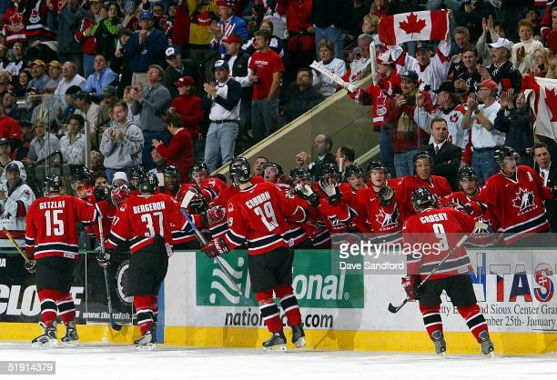 Members of Team Canada celebrate their second goal against Team Russia during the gold medal game at the World Jr. Hockey tournament on January 4,...