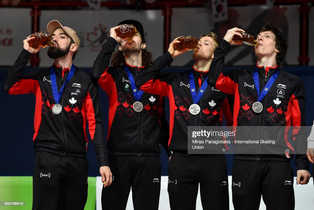 Members of Team Canada drink maple syrup after finishing third in the men's 5000 meter relay Final during the World Short Track Speed Skating Championships at Maurice Richard Arena on March 18, 2018 in Montreal, Quebec, Canada.