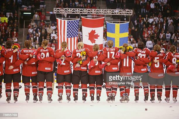 Members of Team Canada listen to the Canadian national anthem after defeating the USA 51 during the IIHF Women's World Championship Gold Medal game...