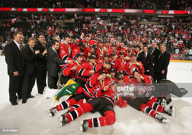 Members of Team Canada pose for a photo with the World Junior Championship trophy after Canada won the gold medal game 61 over Russia at the World...