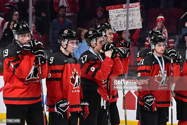 Members of Team Canada react as they look on after losing in the gold medal round game against Team United States during the 2017 IIHF World Junior...