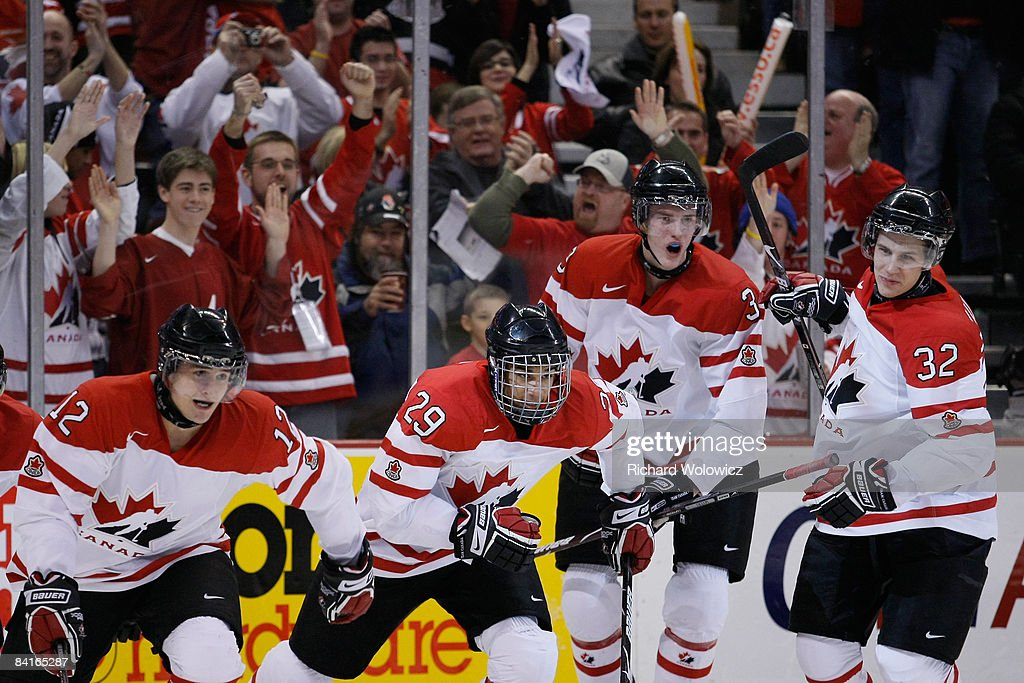 Members of Team Canada skate back to their bench after the first period goal by Brett Sonne #12 of Team Canada during the game against Team Russia at the semifinals at the IIHF World Junior Championships at the Ottawa Civic Centre on January 03, 2009 in Ottawa, Ontario, Canada.