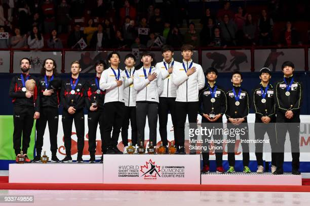 Members of Team Canada Team Korea and Team Japan stand for the Korean national anthem with their medals after completing the 5000 meter relay Final...