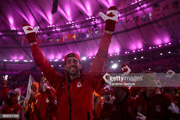 Members of Team Canada walk during the 'Heroes of the Games' segment during the Closing Ceremony on Day 16 of the Rio 2016 Olympic Games at Maracana...