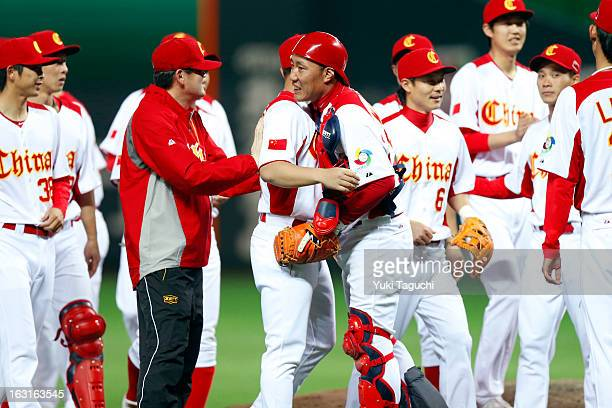 Members of Team China celebrate defeating Team Brazil in Pool A Game 5 in the first round of the 2013 World Baseball Classic at the Fukuoka Yahoo...