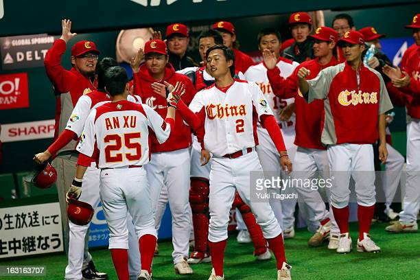 Members of Team China Xiao Cui and Xu An after they scored on a Ray Chang of Team China RBI single in the bottom of the during Pool A Game 5 between...