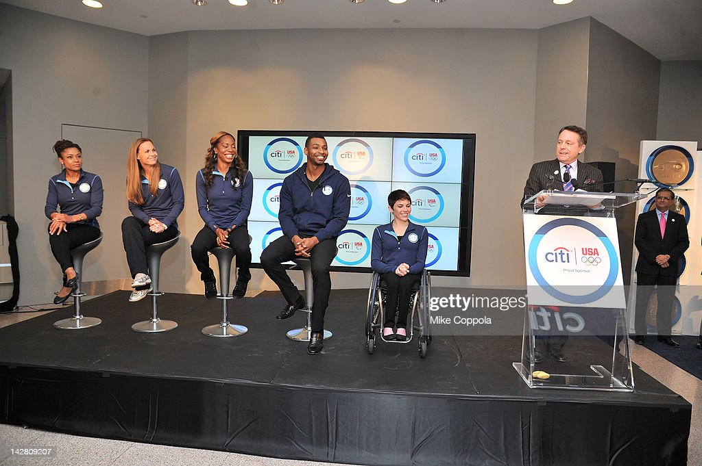 Members of Team Citi Dominique Dawes, Christie Rampone, Sanya Richards-Ross, Cullen Jones, Amanda McGrory, Chief Brand Officer Dermot Boden and Citi Chief Executive Officer Vikram Pandit take a 'signature step' to kick off Citi's Every Step of the Way Olympic program on April 12, 2012 in New York City.