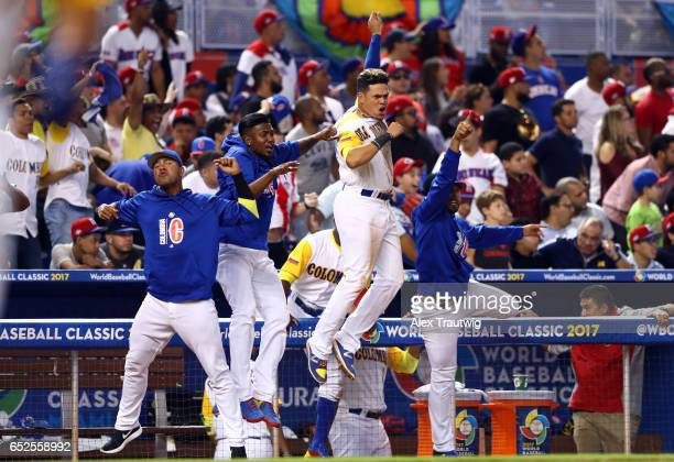 Members of Team Colombia react to a Jorge Alfaro of Team Colombia solo home run in the eighth inning during Game 5 of Pool C of the 2017 World...