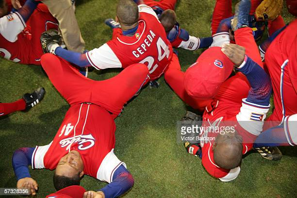 Members of Team Cuba celebrate after the game gainst Puerto Rico on March 15 2006 at Hiram Bithorn Stadium in San Juan Puerto Rico Cuba defeated...