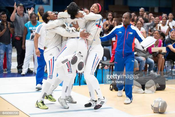 Members of Team Cuba in Junior Women's Sabre celebrate an upset win at the Cadet and Junior PanAmerican Fencing Championships on March 6 2017 at the...