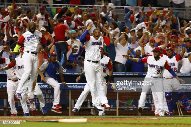 Members of Team Dominican Republic react to a Nelson Cruz threerun home run in the eighth inning during Game 4 Pool C of the 2017 World Baseball...