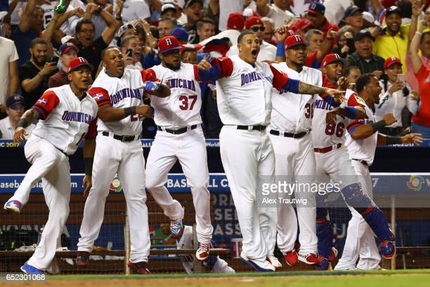 Members of Team Dominican Republic react to a Starling Marte solo home run in the eighth inning during Game 4 Pool C of the 2017 World Baseball...