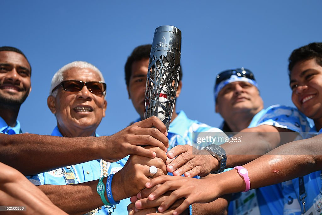 Members of Team Fiji hold the Glasgow 2014 Queen's Baton in the Team Fiji camp at the Commonwealth Games Athletes' Village on July 23, 2014 in Glasgow, Scotland. Scotland is nation 70 of 70 nations and territories the Queen's Baton will visit.