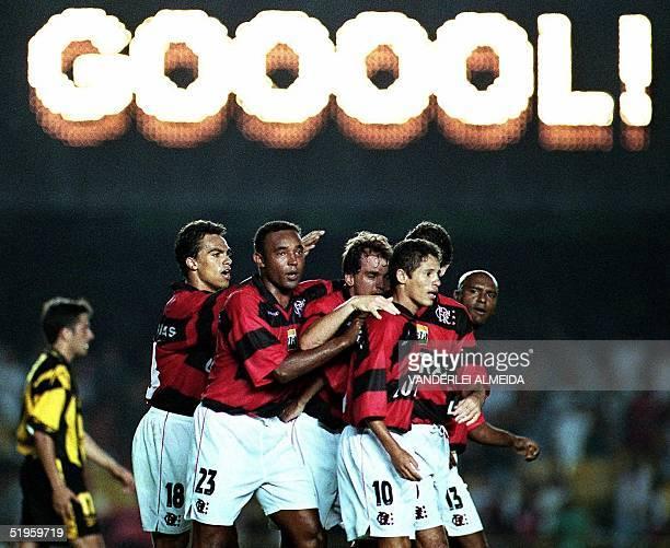 Members of team Flamengo celebrate their second goal against team Penarol of Uruguay during the semifinals of the Mercosur Cup in Maracana Stadium 25...
