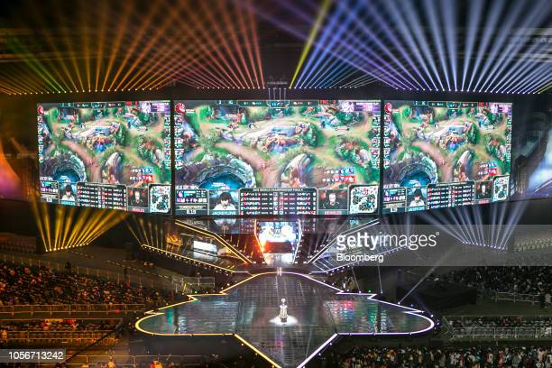 Members of team Fnatic left and Invictus Gaming compete on stage during the League of Legends World Championship Finals hosted by Riot Games Inc in...