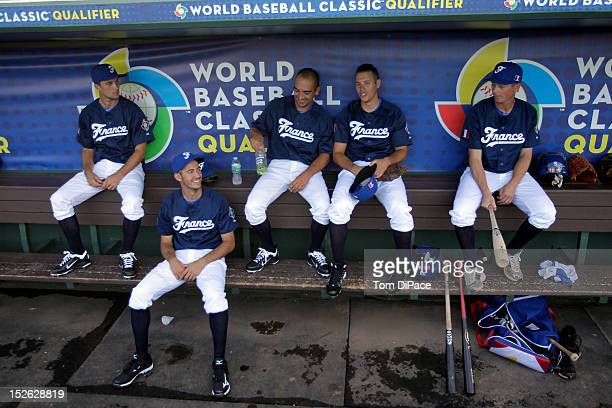 Members of Team France are see in the dugout before game 2 of the Qualifying Round of the 2013 World Baseball Classic against Team Spain at Roger...