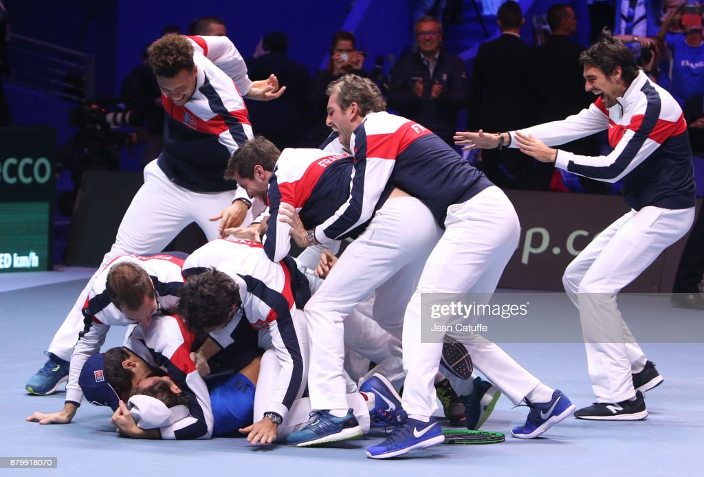 Members of team France celebrate winning the Davis Cup when Lucas Pouille of France beats Steve Darcis of Belgium in the 5th match during day 3 of the Davis Cup World Group final between France and Belgium at Stade Pierre Mauroy on November 26, 2017 in Lille, France.