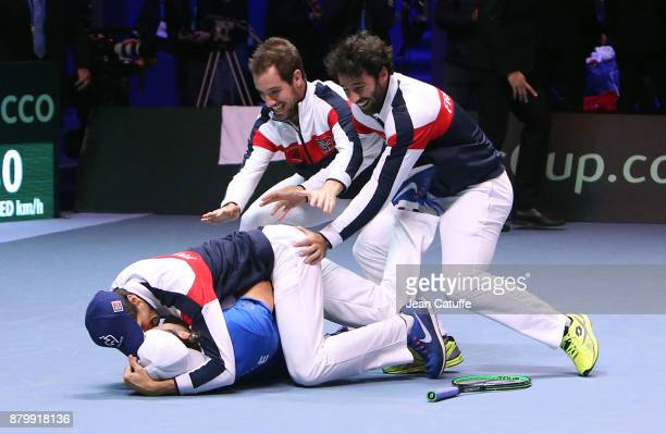 Members of team France celebrate winning the Davis Cup when Lucas Pouille of France beats Steve Darcis of Belgium in the 5th match during day 3 of...