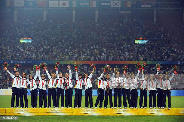 Members of team Germany celebrate with their bronze medals during the medals ceremony of the women's football in the 2008 Beijing Olympic Games in...