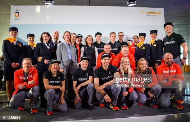 Members of Team Germany pose with crew members of Lufthansa for a picture before the departure to the 2018 PyeongChang Olympic Games at Airport...