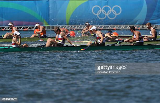 Members of Team Germany reacts after winning the silver medal in the Men's Eight Final A on Day 8 of the Rio 2016 Olympic Games at the Lagoa Stadium...