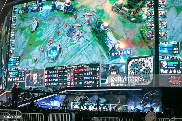 Members of team Invictus Gaming compete on stage during the League of Legends World Championship Finals hosted by Riot Games Inc in Incheon South...