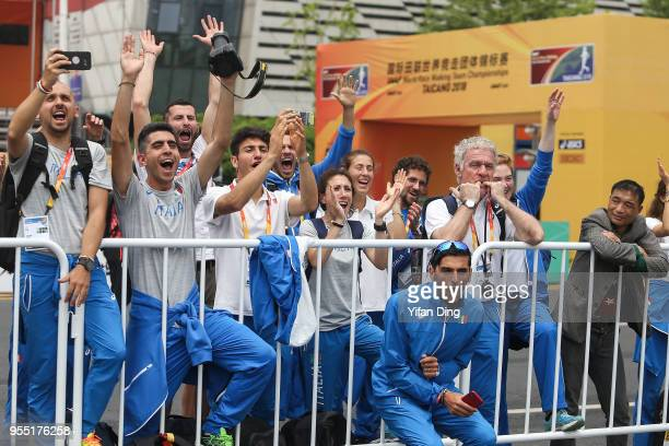Members of team Italy cheer for third place Massimo Stano of Italy during medal ceremony of Men's 20 kilometres Race Walk of IAAF World Race Walking...
