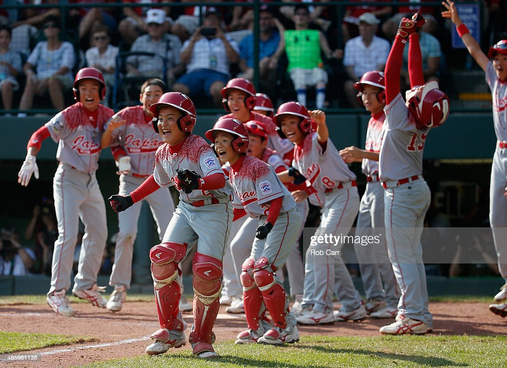 Members of team Japan celebrate while waiting for Masafuji Nishijima #16 (not pictured) to score after hitting a three RBI home run against the Mid-Atlantic team from Red Land Little League of Lewisberry, Pennsylvania during the third inning of the Little League World Series Championship game at Lamade Stadium on August 30, 2015 in South Willamsport, Pennsylvania.
