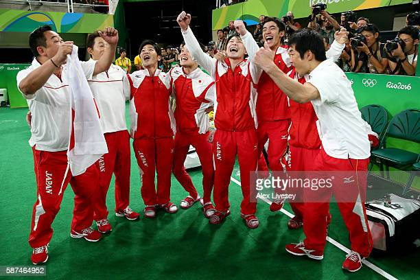 Members of Team Japan celebrate winning the gold during the men's team final on Day 3 of the Rio 2016 Olympic Games at the Rio Olympic Arena on...