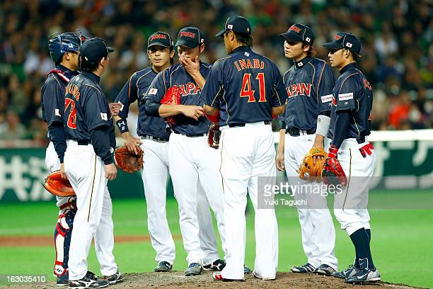 Members of Team Japan meet on the mound during Pool A Game 1 between Team Japan and Team Brazil during the first round of the 2013 World Baseball...