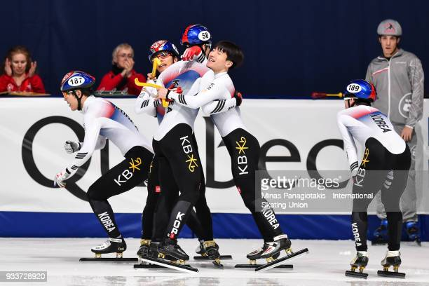 Members of team Korea celebrate after placing first in the men's 5000 meter relay Final during the World Short Track Speed Skating Championships at...