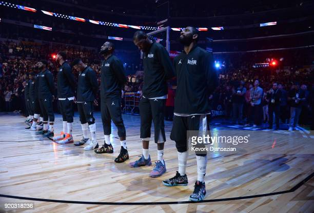 Members of Team LeBron line up on the court for the singing of the US National Anthem prior to the NBA AllStar Game 2018 at Staples Center on...