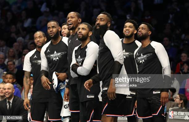 Members of Team LeBron watch play from the bench in the third quarter during the NBA AllStar game as part of the 2019 NBA AllStar Weekend at Spectrum...