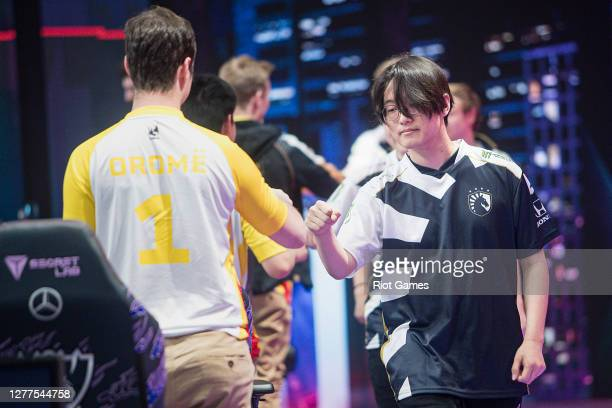 Members of team Liquid greet opponents after winning a game between team Liquid and team MAD Lions during the League of Legends 2020 Worlds Play-ins...