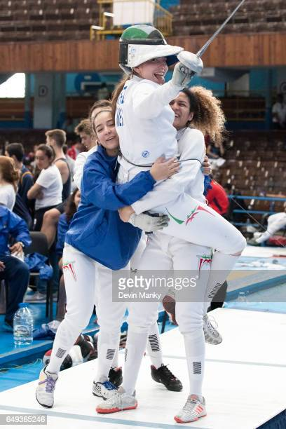 Members of Team Mexico celebrate a team victory in the quarterfinals during competition in the Junior Team Women's Epee competition at the Cadet and...