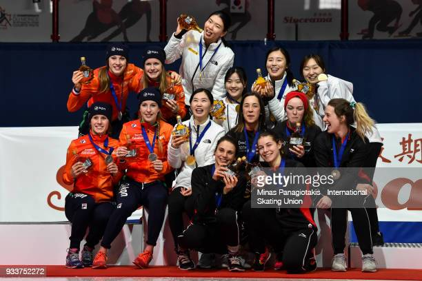 Members of Team Netherlands Team Korea and Team Canada pose for a photo with their medals after finishing in the women's 3000 meter relay Final...
