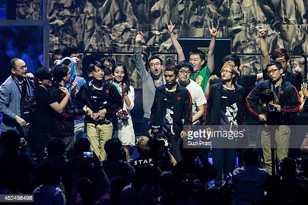 Members of team Newbee celebrate with their freinds and family on stage following their win at The International DOTA 2 Championships on July 21 2014...